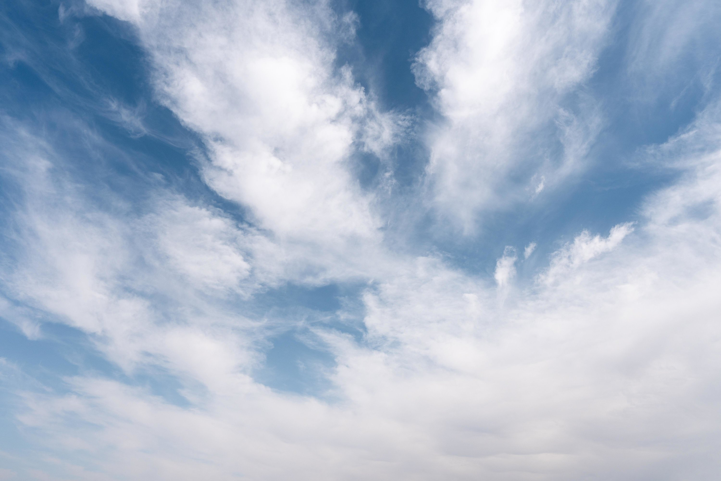 Banner image featuring a photo of the sky with clouds, via freepik.